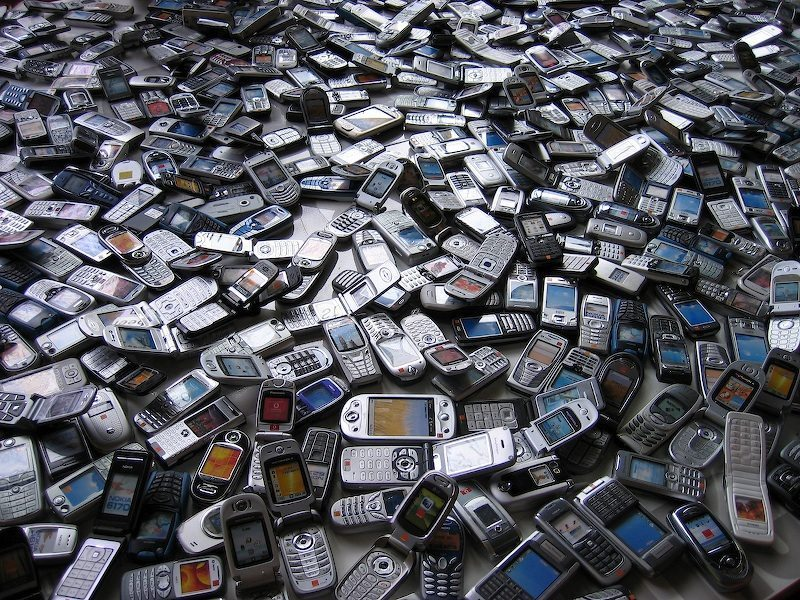 Image: a pile of old cell phones
