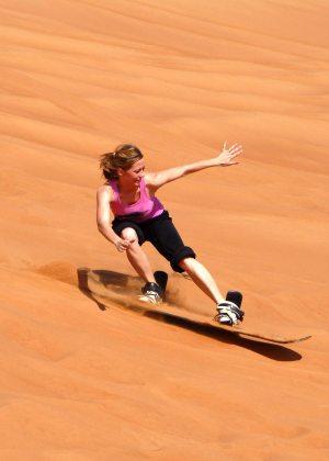 Image: Threshold for something new. Girl sand-boarding.
