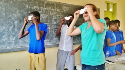 Image: People looking through paper microscopes