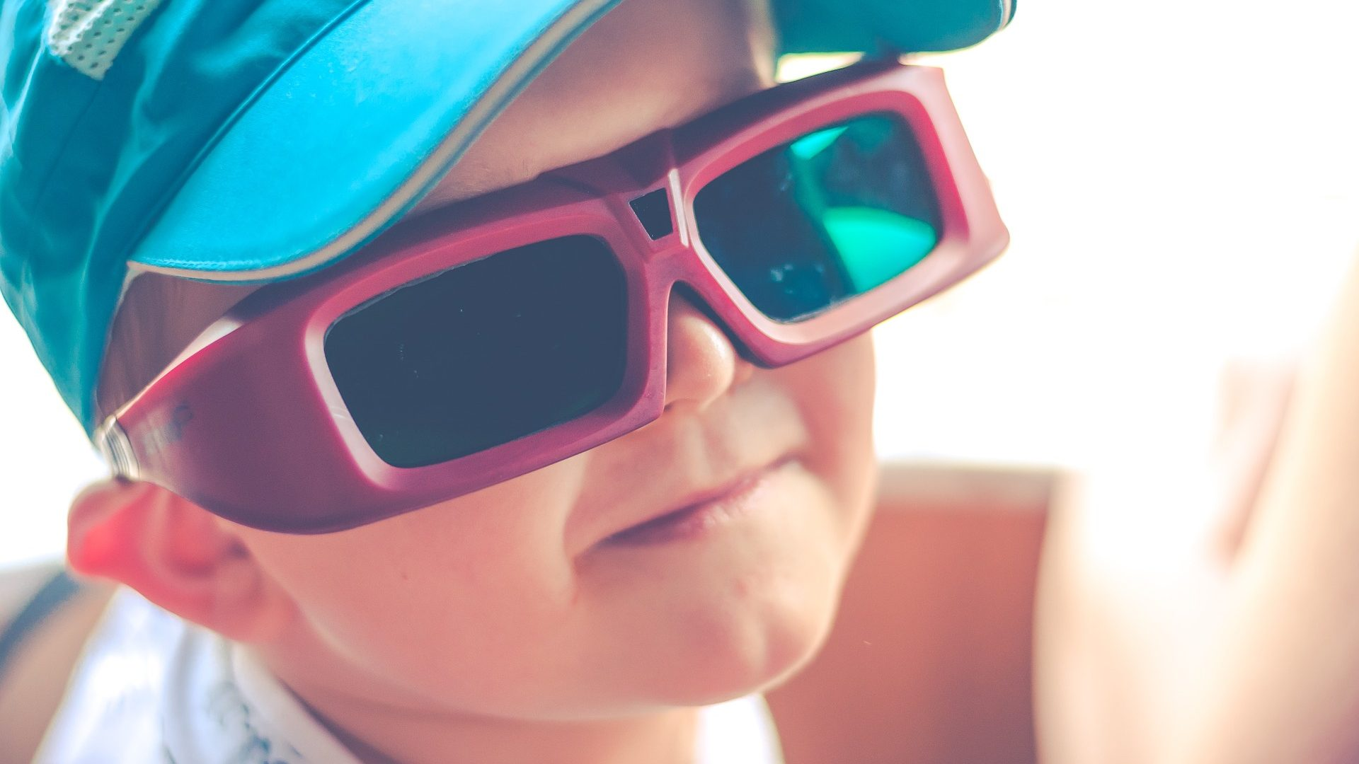 Image: a child wearing 3D glasses