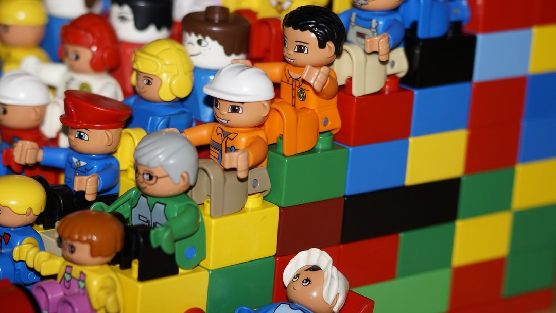 Image: Lego people on a stair step of Lego block