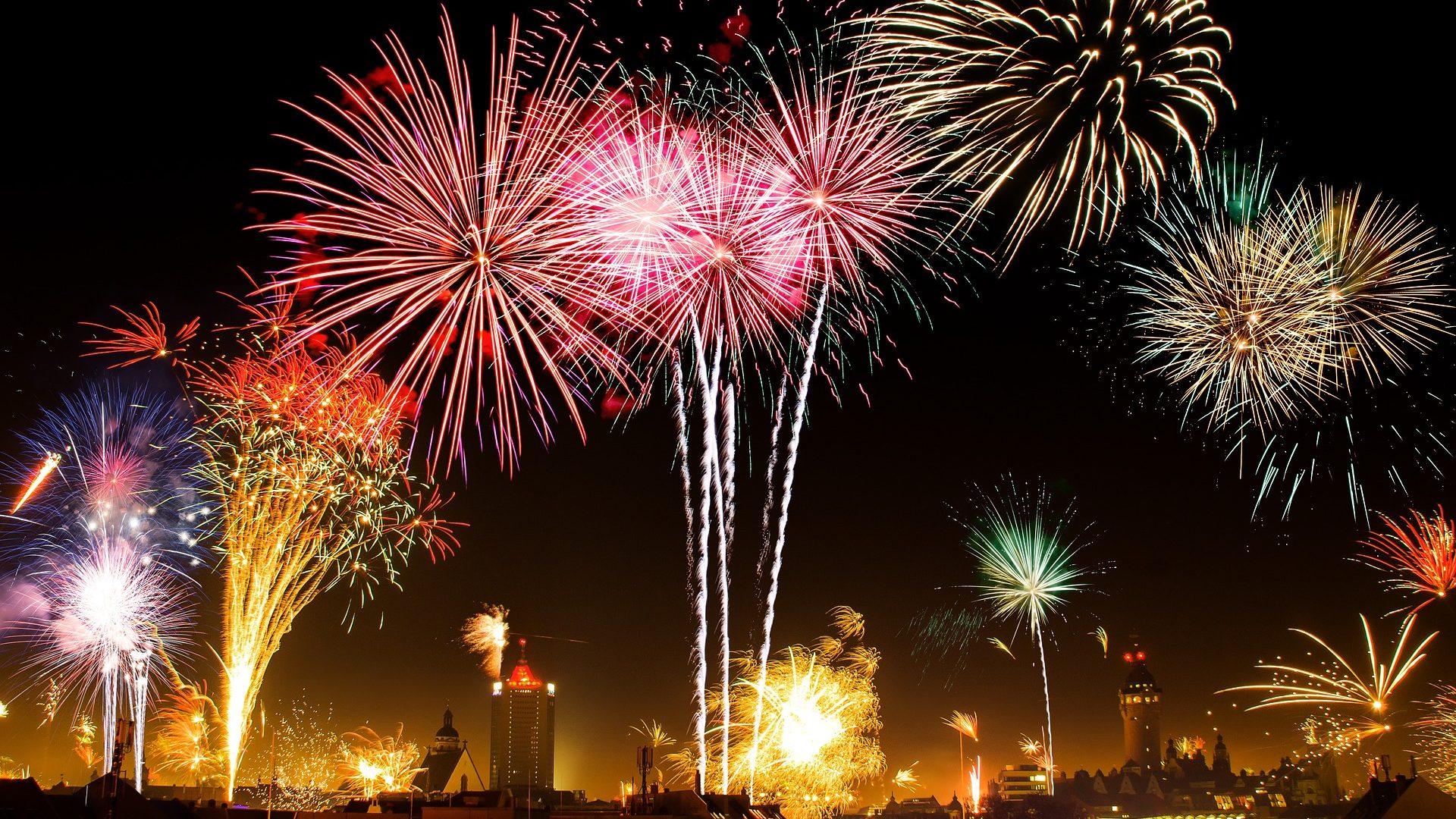 Image: Fireworks exploding above a city skyline