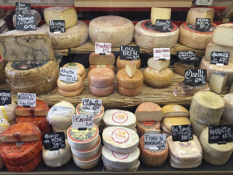 Image: variety of cheese at a market!