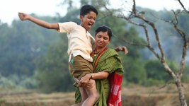 Image: Mother holding a very big son who is joyous