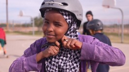 Image: Young girl clicking in her helmet