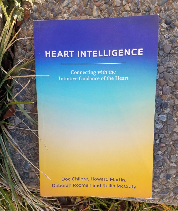 Blue fading into yellow on the cover page of Heart Intelligence book.