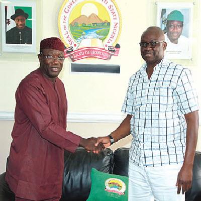 Rising above politics, Fayemi, Fayose embrace in Lagos