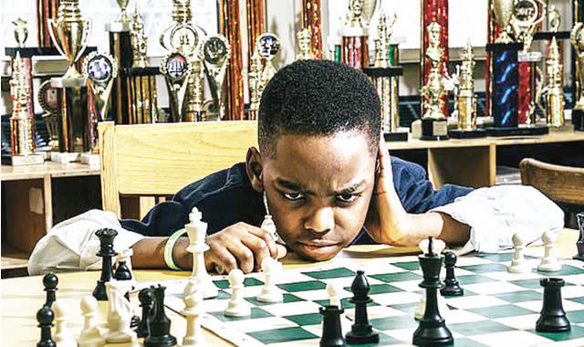 8-year-old Nigerian refugee living in homeless shelter wins New York chess championship