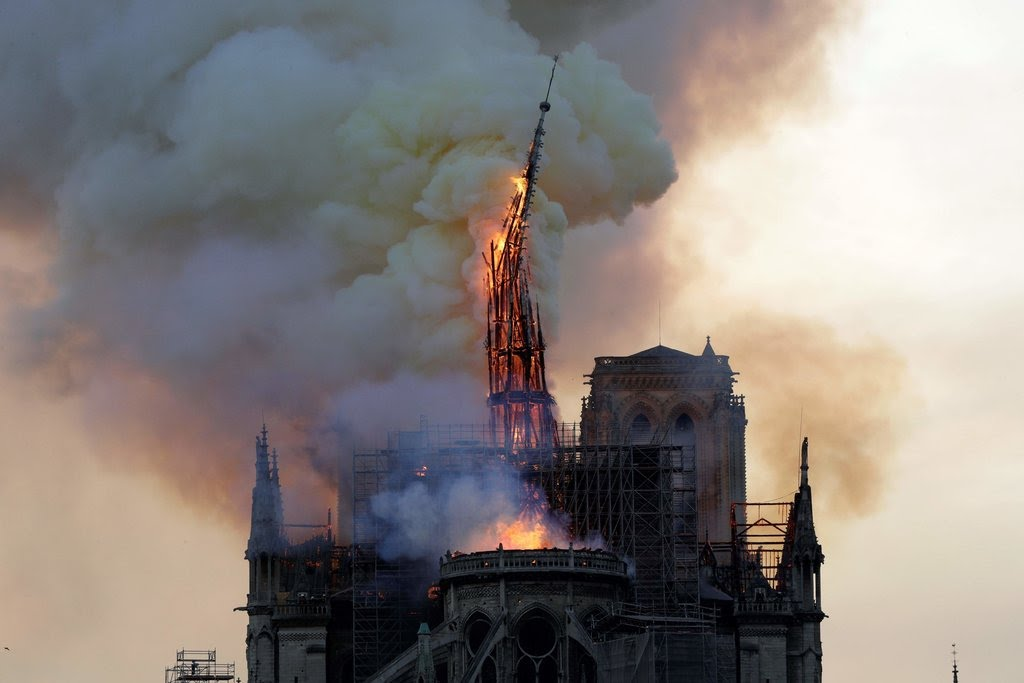 Part of Notre-Dame Spire Collapses as Paris Cathedral Catches Fire