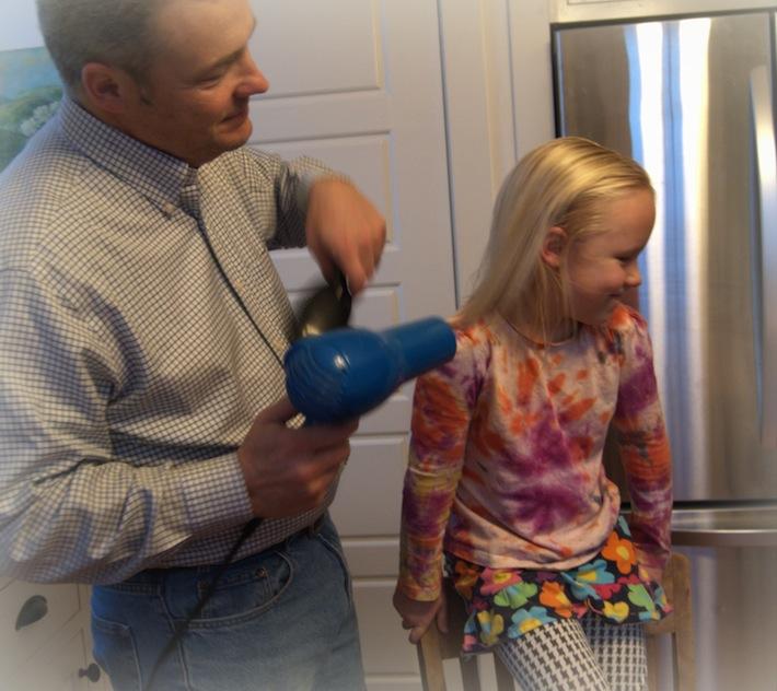 dad drying Nora's hair