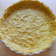 Pastry in a quiche dish before cooking