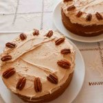 Coffee Cake with butter icing and decorated with pecans