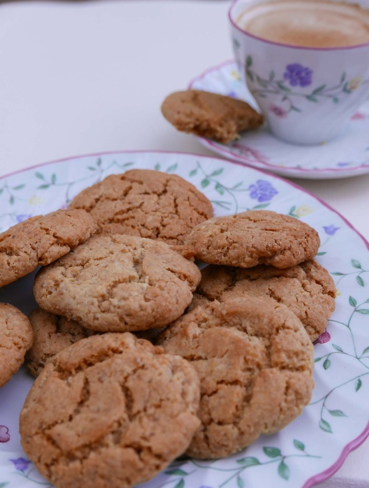 Ginger Biscuits on a plate with a cup of tea