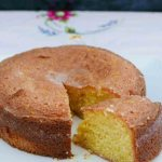 Lemon Drizzle Cake on a plate with a cut slice