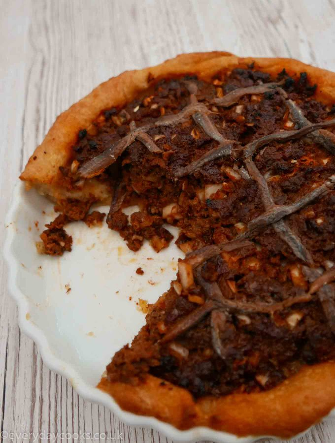 Savoury Mince Pie with Potato Pastry with a slice missing