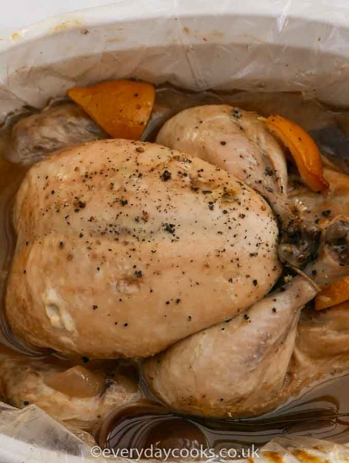 Slow Cooker Whole Chicken in a white dish
