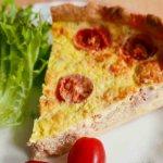 A slice of Tuna and Tomato Quiche with salad