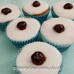 Six Cherry Bakewell Cupcakes on a cloth