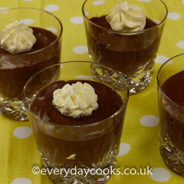 4 glasses of Easy Chocolate Mousse decorated with cream swirls