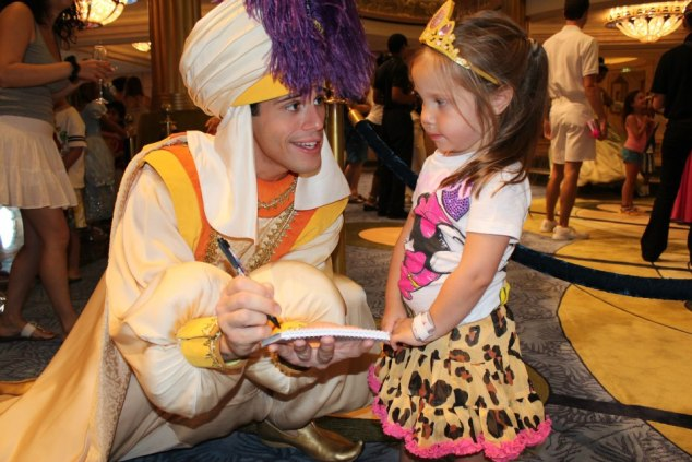 Little girl meeting Aladdin on Disney Cruise