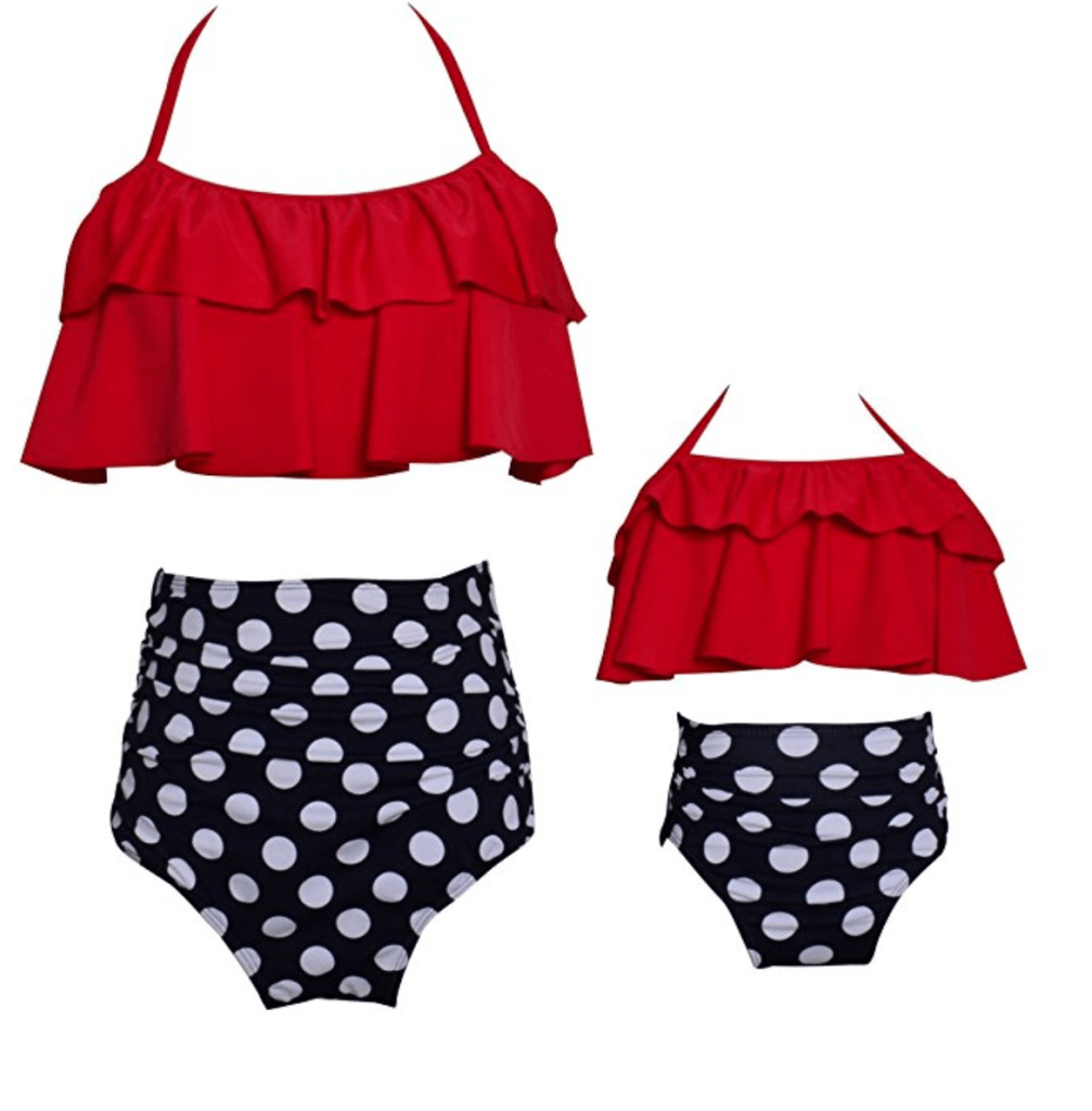 A mother-daughter matching swimsuit set. Red bikini top and black and white polka dot bottoms