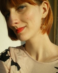 Red Lips, Sparkly Earrings
