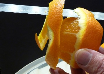 Using a serrated knife to peel an orange (c) jfhaugen
