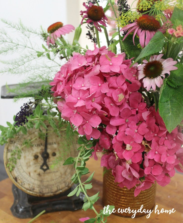 English Flowers in a Rusty Can   The Everyday Home   www.everydayhomeblog.com