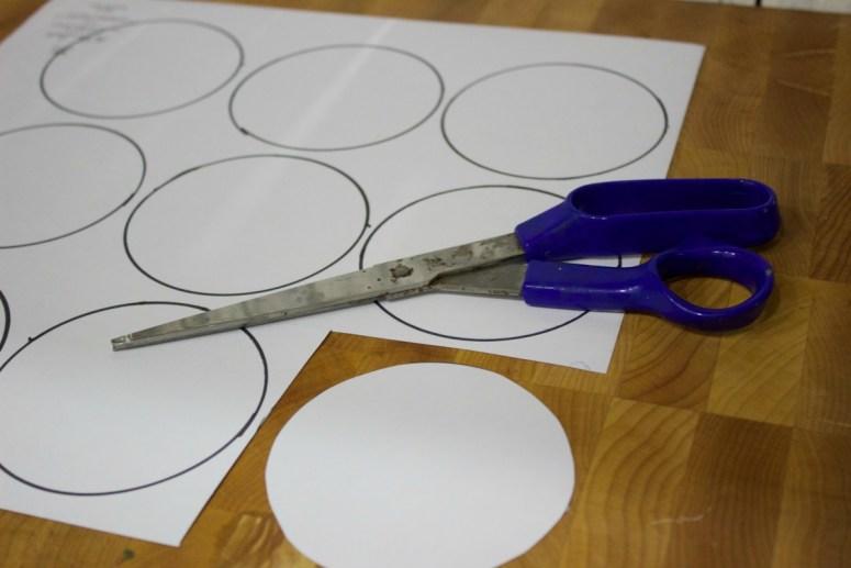 cutting-scrapbppk-paper-for-christmas-ornaments   The Everyday Home   www.everydayhomeblog.com