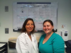 Angel Amaral, PharmD, and Stephanie Sciaraffa at the Medical Center Memorial Campus Outpatient North Idea Board.