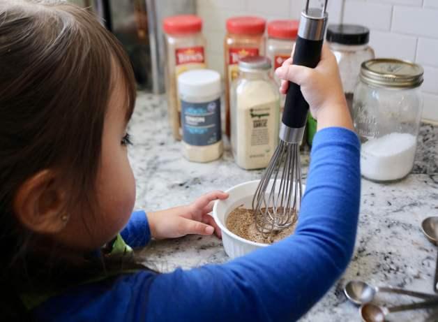 Little girl mixing homemade taco seasoning #homemadetacoseasoning