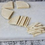 Cutting tortilla strips #sopadetortillaazteca #tortillasoup
