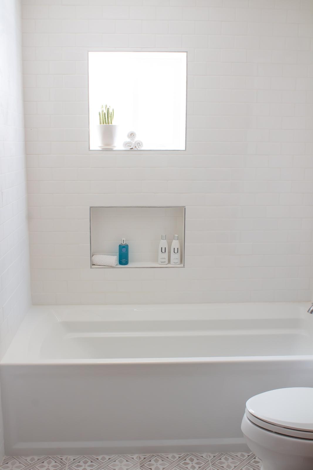 Bathtub shower combo with subway tile