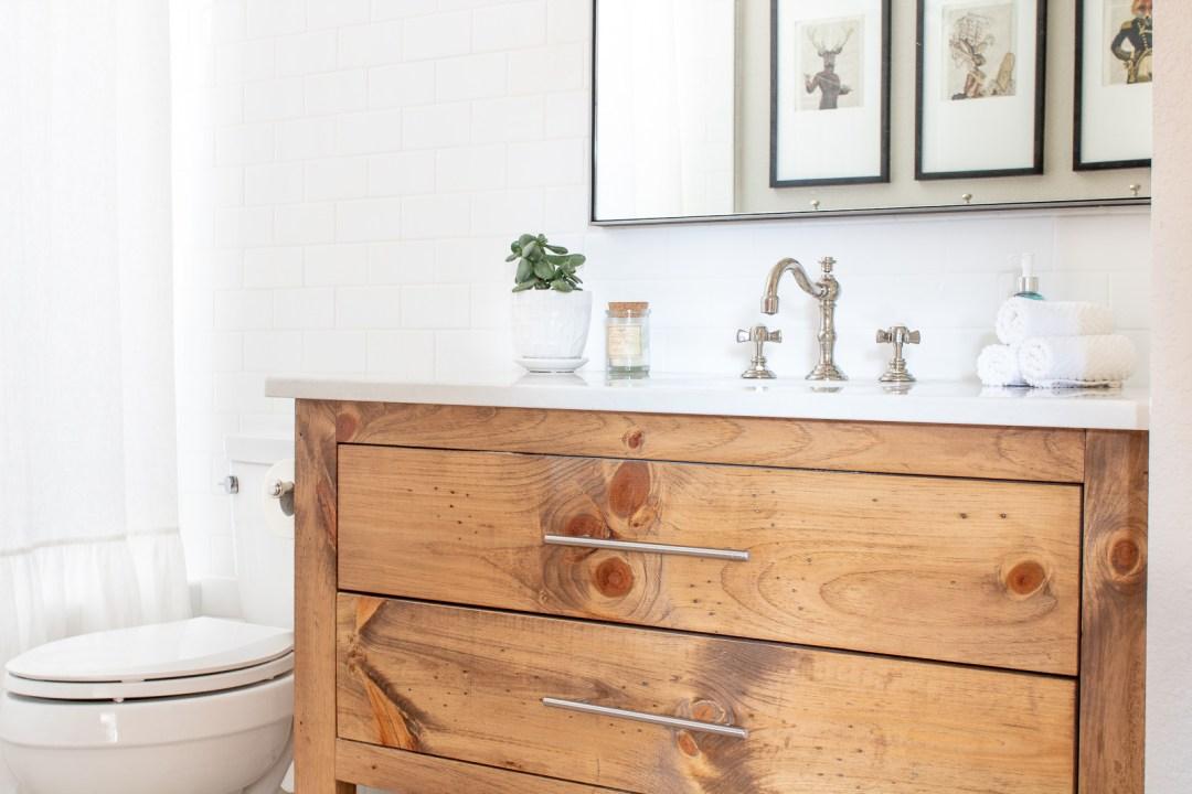 White subway tile bathroom with wood vanity