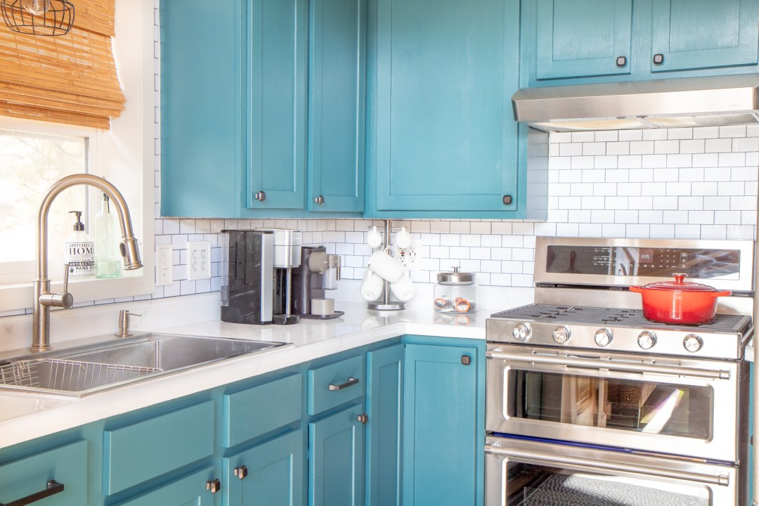 Teal kitchen cabinets white subway tile