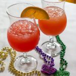 Two Hurricane Cocktails Mardi Gras Beads