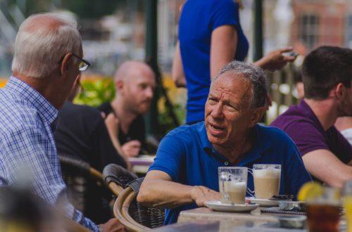Two men talking, not happy