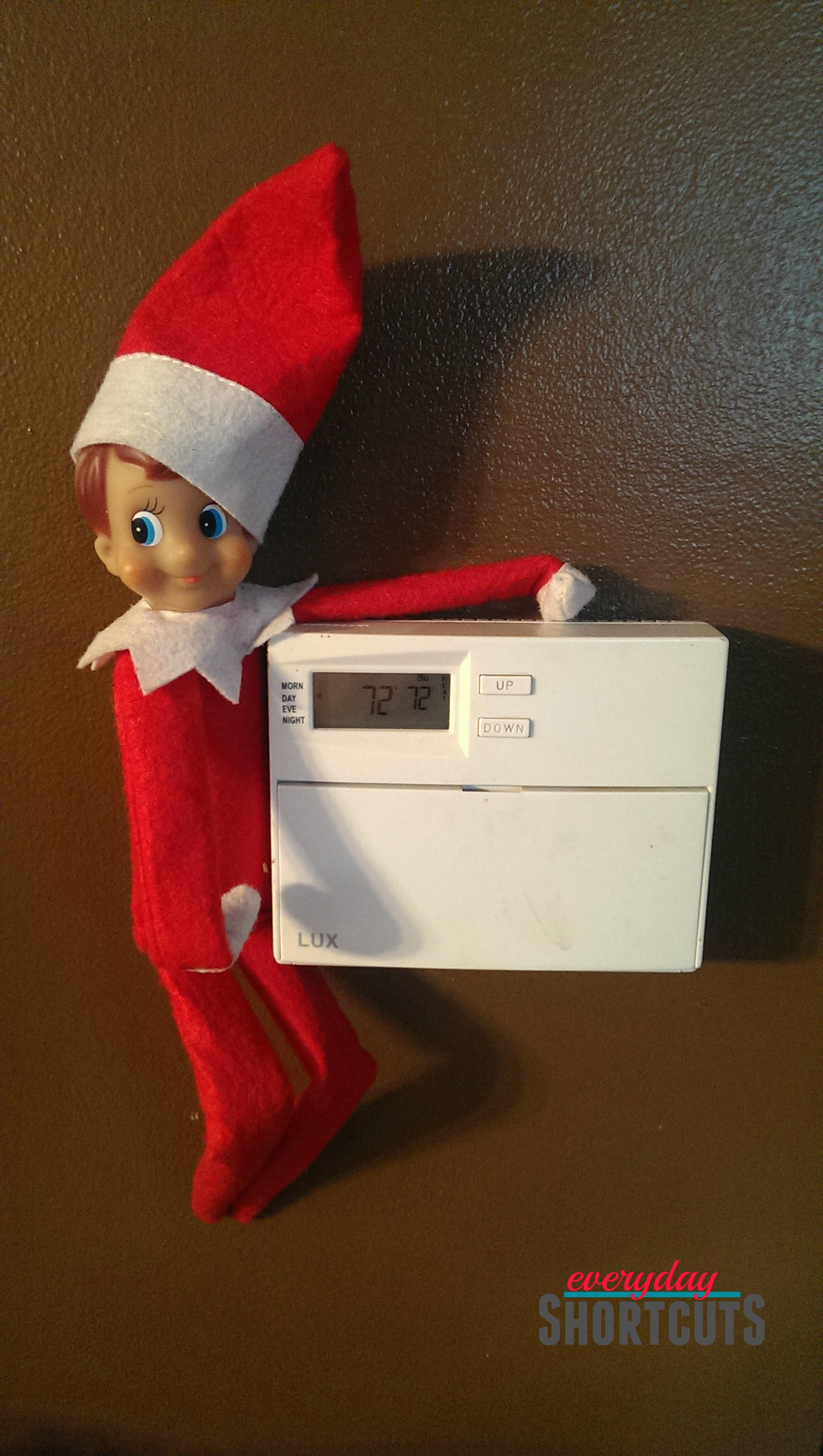 elf on the shelf changing the thermostat