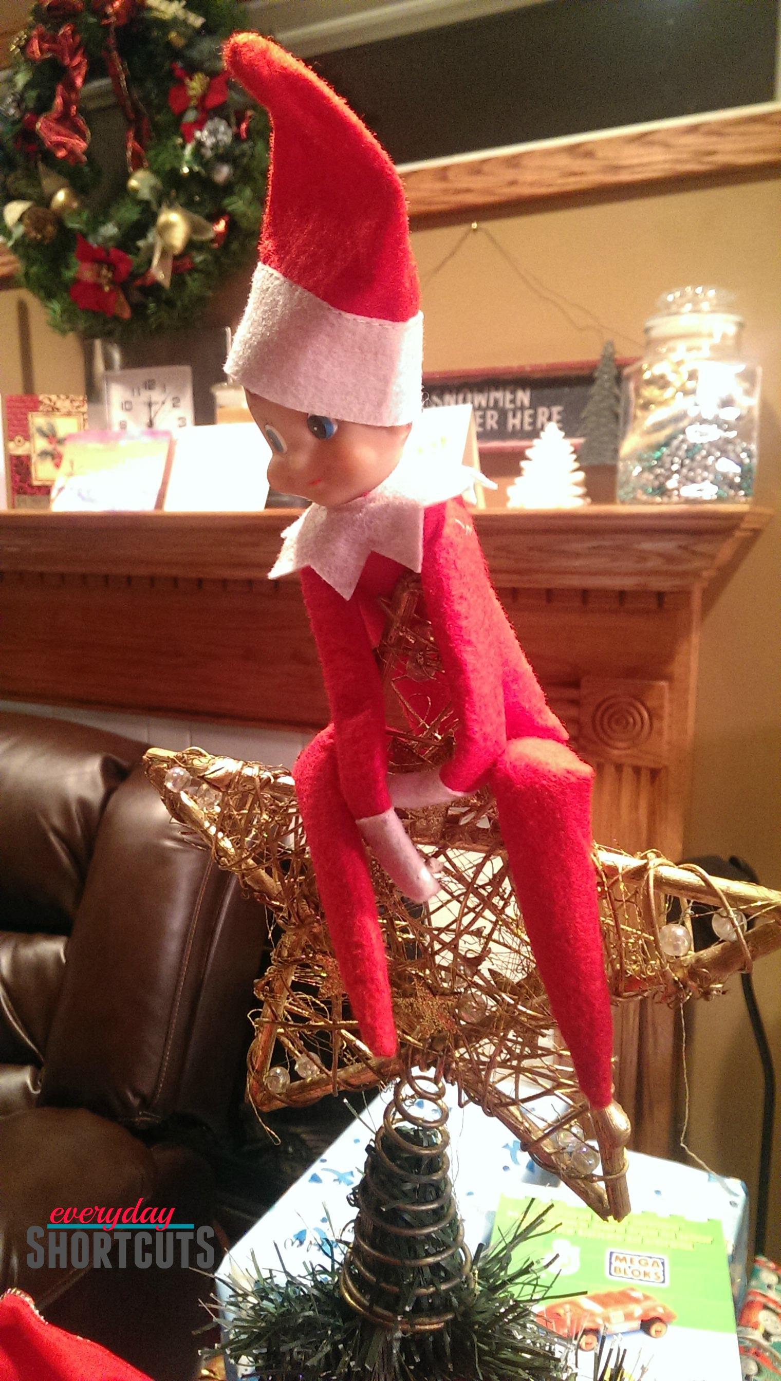 elf on the shelf on christmas tree star