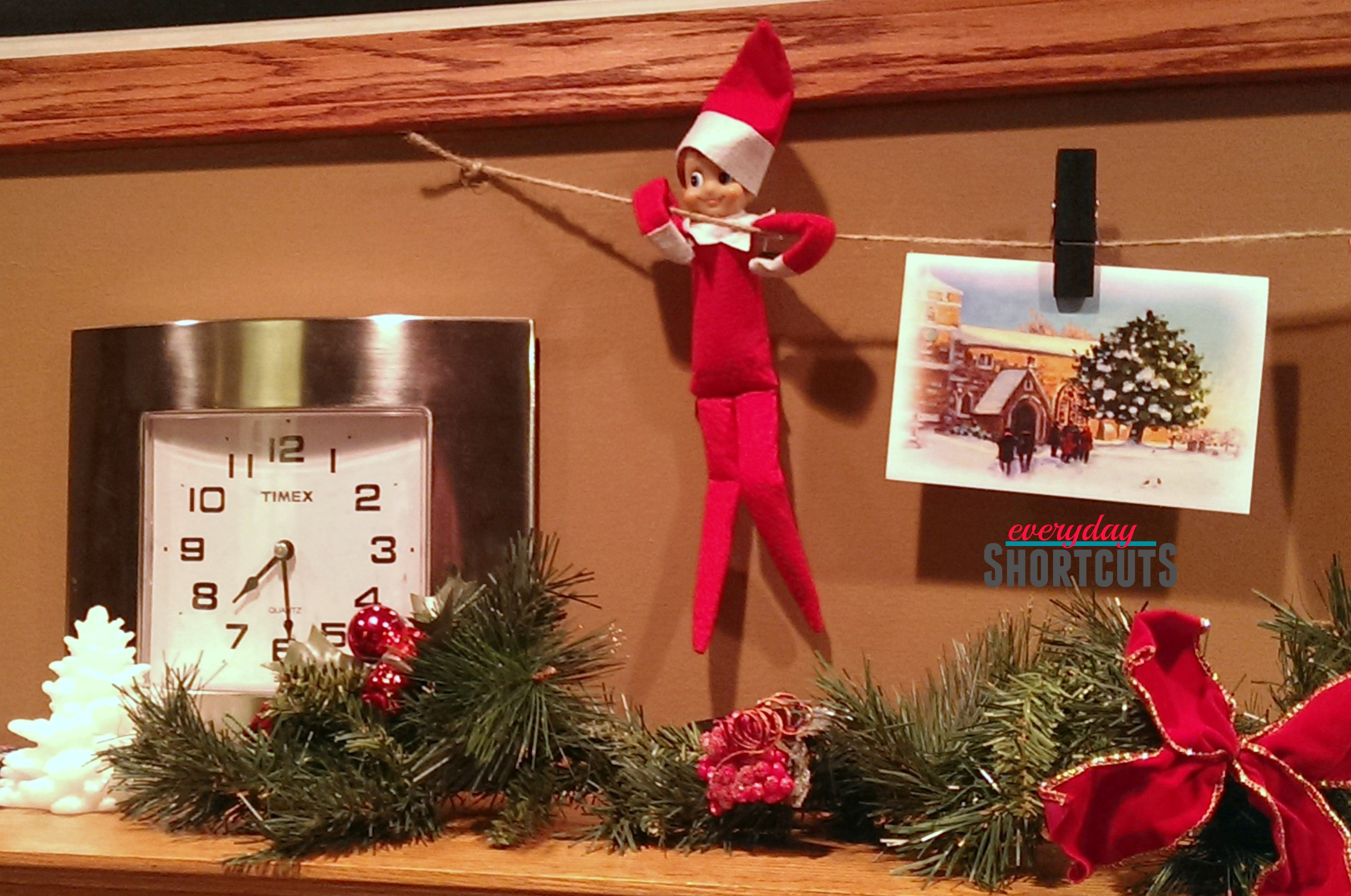 elf on the shelve with christmas cards