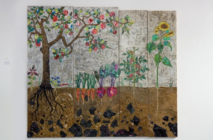 """Garden of Hope,"" created from Seattle street litter, staples, and shellac on recycled doors"