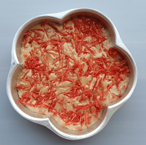 Transfer the carrot cake batter into a greased tray