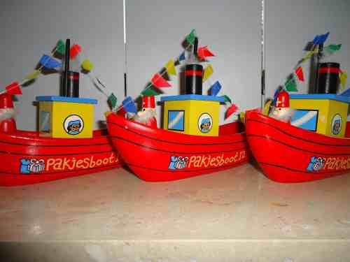 Sinterklaas arrives from Spain on a boat called Pakjesboot.