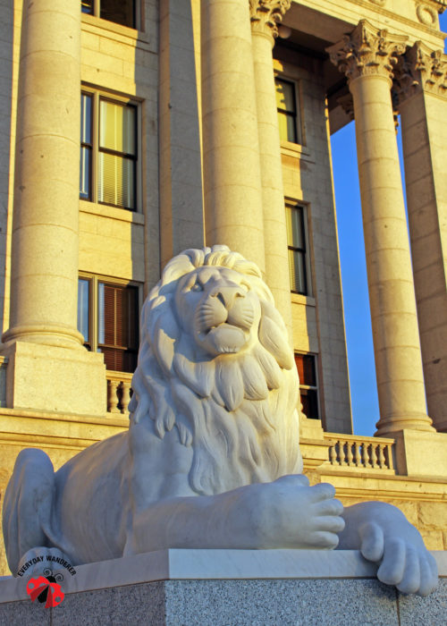 A marble lion guards the entrance to the Utah State Capitol