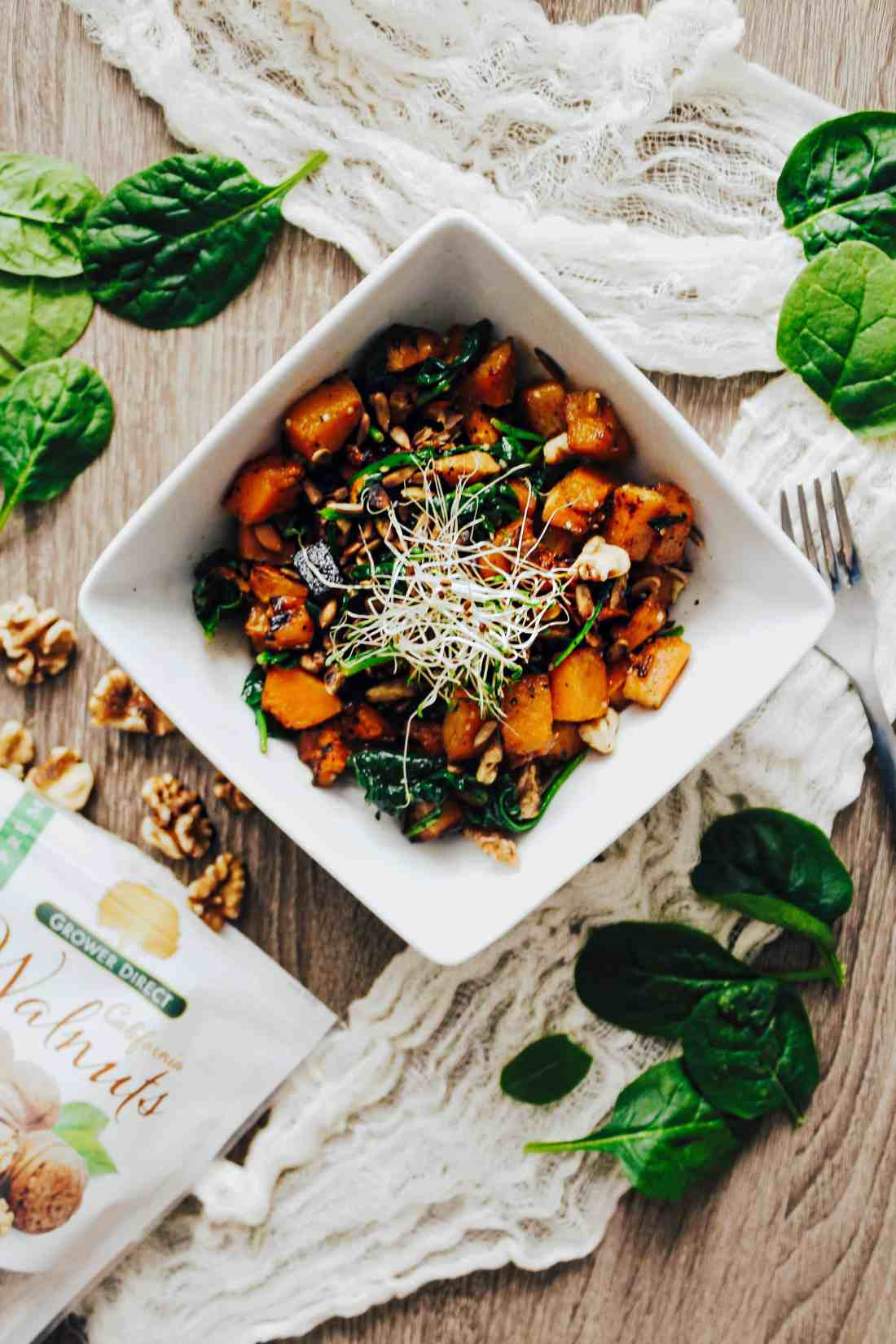 This roasted Butternut Squash & Spinach Salad with toasted walnuts & seeds makes for the perfect gluten free & plant based side dish!