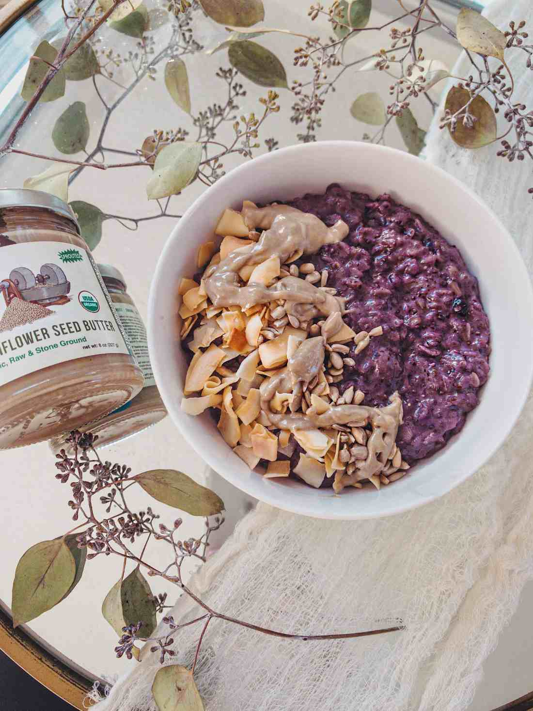 This easy recipe for creamy coconut & blueberry oatmeal is the perfect fall breakfast that'll leave you feeling nourished all morning. Gluten free & vegan!