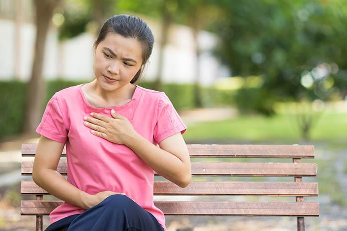 Woman has reflux acids in the garden