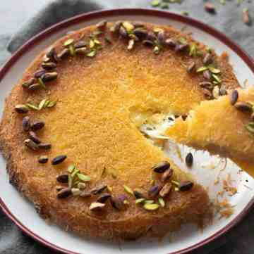 Cheese and cream filled Kunafa with a crispy top with pistachio and sugar syrup