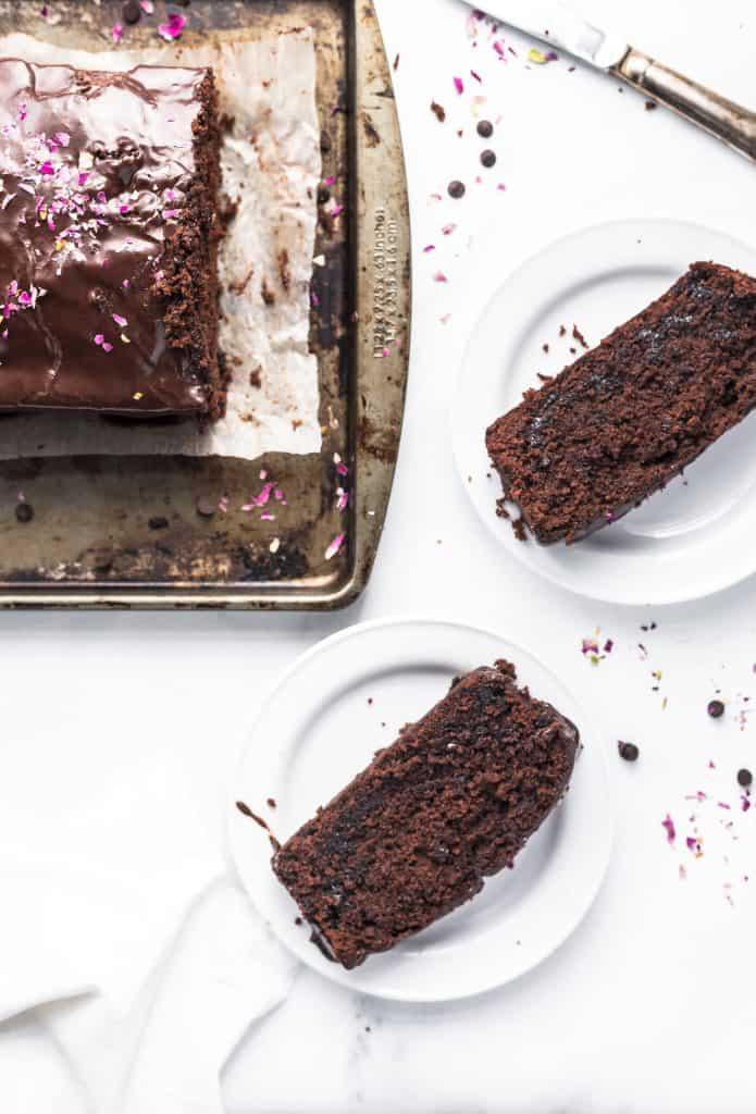 chocolate loaf cake with chocolate ganache sliced onto plates.