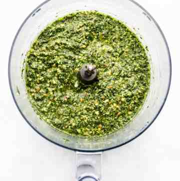 Homemade pesto sauce blended in the bowl of a food processor